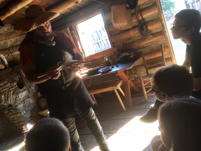 Learning the correct technique for carding wool.
